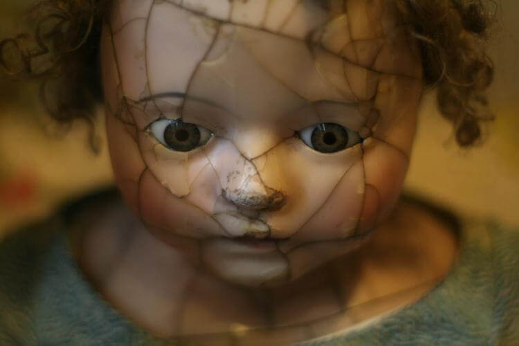 Injured doll head