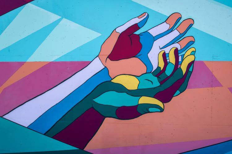 Illustration of two hands, one in the other